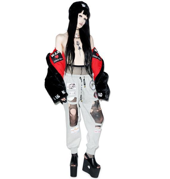 W.I.A X Dolls Kill Hole Sweatpants