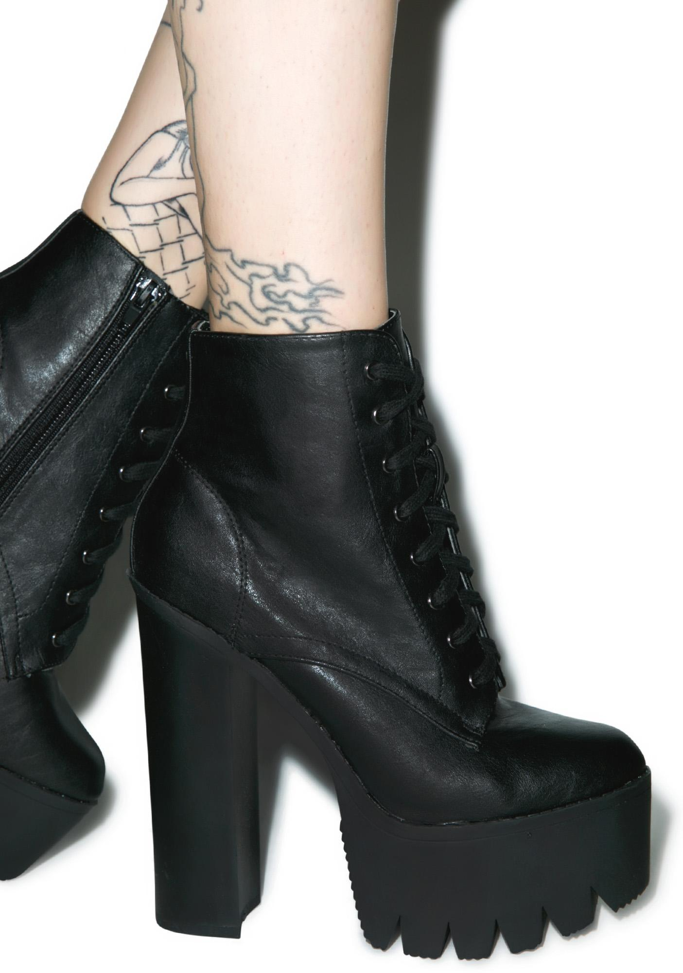 A boot with serious attitude the Gravedigger is a mid-calf boot with a 2 3 4 inch platform. The front of.